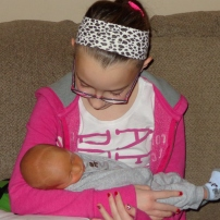 Tweedle Dee meeting her new cousin, Ryley.